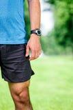 Closeup of a male runner standing - Stock Photos