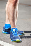 Closeup of a male runner standing. Space for text. Fitness concept Stock Photos