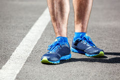 Closeup of a male runner standing Stock Photos