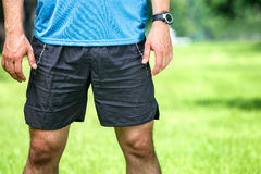 Closeup of a male runner standing. Stock Photos