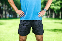 Closeup of a male runner standing. Closeup of a male runner standing - space for text. Fitness concept Stock Photo