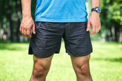 Closeup of a male runner standing. Closeup of a male runner standing - space for text. Fitness concept Royalty Free Stock Photo