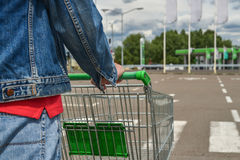 Male shopper with trolley. Closeup of male shopper with trolley at parking of supermarket Stock Images