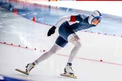 Closeup of a male skater to race sprint. Chelyabinsk, Russia - August 25, 2016: closeup of a male skater to race sprint during Summer Cup in speed skating Royalty Free Stock Image