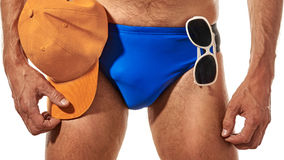 Closeup of male swimmer. Part of Male athlete in swimming briefs with orange cap and glasses Royalty Free Stock Photo