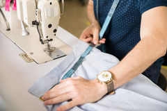 Closeup of male tailor at work Royalty Free Stock Images