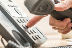 Closeup of male telemarketing salesperson holding a telephone re stock photos