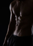 Closeup on male torso with abdominal muscles Royalty Free Stock Photography