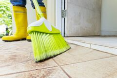 Free Closeup Male Worker Cleaning The Floor With A Broom Stock Photos - 171765883