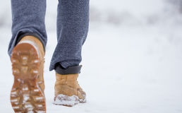 Closeup of male yellow winter shoes on snow.  Stock Photography