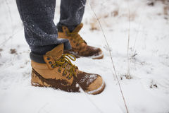 Closeup of male yellow winter shoes on snow Royalty Free Stock Photos