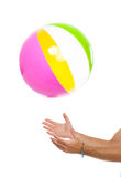 Closeup on males hand throwing beach ball up Stock Images