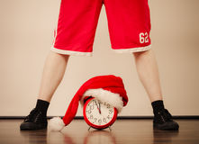 Closeup of man with alarm clock. Christmas time. Royalty Free Stock Images