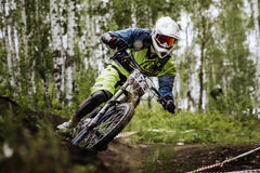 Closeup man athlete mountain biking around sharp turn Royalty Free Stock Image