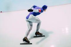Closeup man athlete speedskater on track sprint race Stock Photo