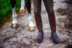 Closeup of man in boots and his horse Stock Photography