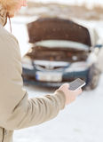 Closeup of man with broken car and cell phone. Transportation, winter and vehicle concept - closeup of man with broken car and cell phone Stock Images
