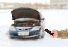 Closeup of man with broken car and smartphone. Transportation, winter and vehicle concept - closeup of man with broken car and smartphone stock photography