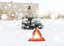 Closeup of man with broken car and smartphone. Transportation, winter, people and vehicle concept - closeup of man with broken car and cell phone Stock Photos