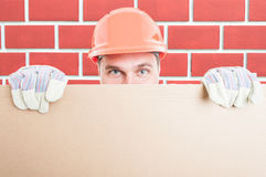 Closeup of man builder holding big placard. Or banner with copys pace area Stock Image