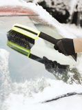 Closeup of man cleaning snow from car Royalty Free Stock Photo