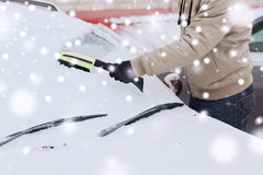 Closeup of man cleaning snow from car Royalty Free Stock Photography