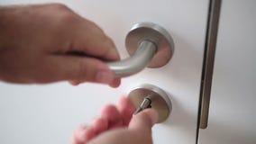 Closeup of man closing a door and locks it stock video