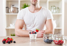 Closeup on man with delicious yoghurt with fresh berries. Healthy eating concept. Closeup on man with delicious yoghurt with fresh berries royalty free stock photos