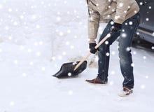Closeup of man digging snow with shovel near car Royalty Free Stock Photos
