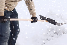 Closeup of man digging snow with shovel Royalty Free Stock Photo