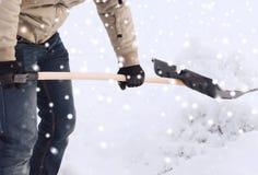 Closeup of man digging snow with shovel Royalty Free Stock Photo