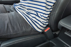 Closeup of man driving a car and no use seat belt. Closeup of buckle Stock Images