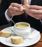 Closeup of man eating a bowl of soup Stock Image