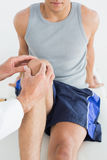 Closeup of a man getting his knee examined Royalty Free Stock Images