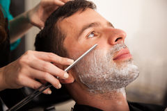 Closeup of a man getting shaved Royalty Free Stock Images