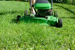 Closeup of man cutting the lawn stock images