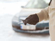 Closeup of man hand with car key outdoors Royalty Free Stock Photos