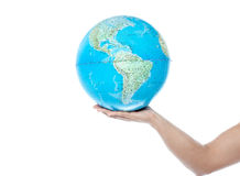 Closeup of man hand holding a globe Stock Photos
