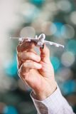 Closeup of man hand holding model of airplane Stock Photos