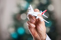 Closeup of man hand holding model of airplane Royalty Free Stock Images