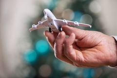 Closeup of man hand holding model of airplane Stock Photo