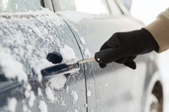 Closeup of man hand opening car with key Royalty Free Stock Image