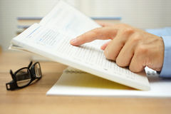 Closeup of man hand reading a book Stock Images