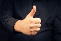 Closeup man hand showing thumb Stock Photos