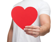 Closeup of man hands with heart. Relationships and love concept - closeup of man hands with heart Royalty Free Stock Photography