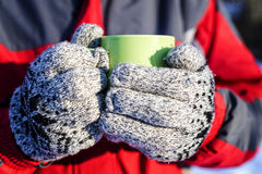 Closeup of man hands holding a cup of hot drink Stock Images