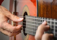 Closeup of a Man hands playing classical gutar Stock Images