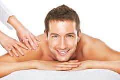 Closeup of a man having a back massage Stock Photos