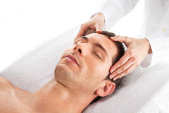 Closeup of a man having a head massage Royalty Free Stock Photo