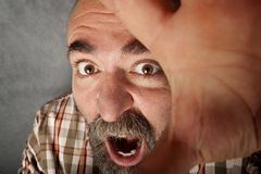 Closeup of man in his 40s screaming Royalty Free Stock Photography